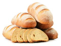 Stock Photo of composition with loafs of bread isolated on white background