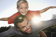 Germany, cologne, father carrying son, pretending to fly Stock Photos