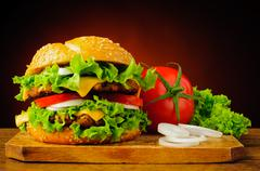double cheeseburger and fresh vegetables - stock photo