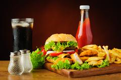 Hamburger, chicken nuggets, french fries, cola and ketchup Stock Photos