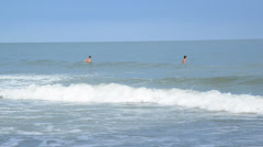 Surfers wating on waves Stock Footage
