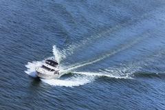 luxury power boat yacht on blue sea - stock photo