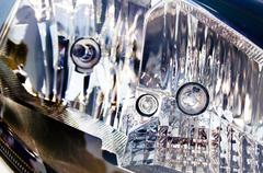 Extreme abstract closeup of vehicle headlamp Stock Photos