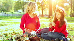 Mother and daughter having fun on sunset light in autumn park. Stock Footage
