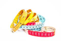 Three colorful tape measures Stock Photos