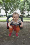 Stock Photo of germany, hesse, frankfurt, portrait of baby boy swinging
