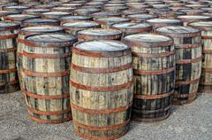 stacked whisky casks and barrels - stock photo