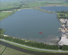 Aerial sand and gravel mining in river landscape, river Rhine Stock Footage