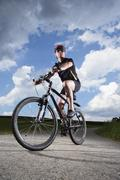 Germany, bavaria, mature man riding mountain bike Stock Photos