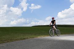 germany, bavaria, mature man riding mountain bike - stock photo