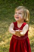 Germany, baden wuerttemberg, girl looking up, smiling, close up Stock Photos