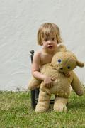 Germany, baden wuerttemberg, portrait of girl holding teddy bear Stock Photos