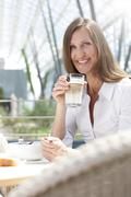 businesswoman having lunch break - stock photo