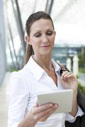 Businesswoman holding digital tablet Stock Photos