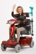 Stock Photo of Disabled elderly woman beckons