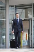 germany, hannover, businessman walking with briefcase at terminal - stock photo