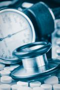 pills, stethoscope and sphygmomanometer - stock photo