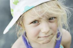 Stock Photo of germany, north rhine westphalia, cologne, portrait of girl with cap, close up
