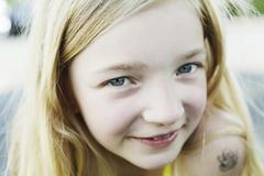germany, north rhine westphalia, cologne, portrait of girl, smiling, close up - stock photo
