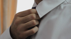 Stock Video Footage of Businessman tying his tie preparing for meeting