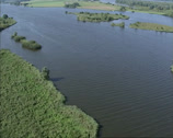 Stock Video Footage of Aerial shot network of rivers and creeks with islands in Biesbosch national park