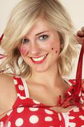 Portrait of young woman in carnival dress, smiling, close up Stock Photos