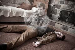 happy soul leaving a corpse lying on the floor - stock photo