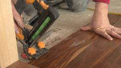 Home construction, hardwood floor install, nailer, close up Stock Footage