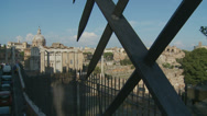 Stock Video Footage of View of Ancient Rome through metal bars 1 (slomo dolly)
