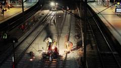 Railroad workers make repairs rails Stock Footage