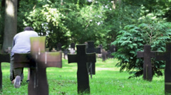 Man praying at cemetery - stock footage
