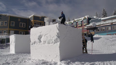 Snow sculpture, blocks piled waiting for sculpting Stock Footage