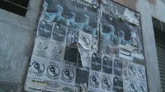 Italian backstreet discarded posters (slomo dolly) Stock Footage