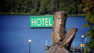 Stock Video Footage of hotel sign over water
