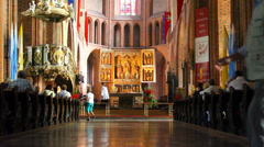 People wait in cathedral for service Stock Footage