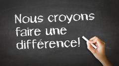 we believe in making a difference (in french) - stock photo