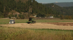 Harvest combine driving in a field (HD) a Stock Footage