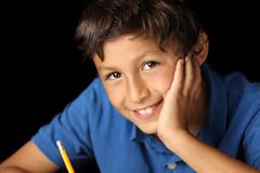 portrait of young boy - chiaroscuro series - stock photo