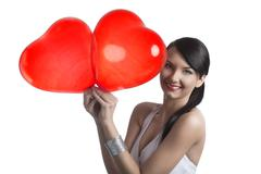 Smiling brunette with two baloons Stock Photos