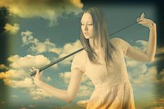 Beautiful woman with golfclub images manipulated Stock Photos
