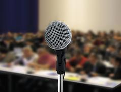 people attending seminar and microphone - stock illustration