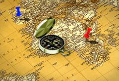 map and  compass with push pin - stock illustration