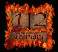 Burning wooden calendar february 12. Stock Illustration