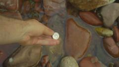 Finding coin river pool Stock Footage