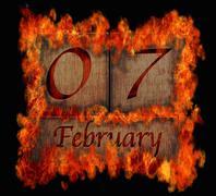 Burning wooden calendar february 7. Stock Illustration