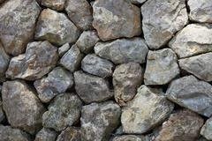 dry stone rock construction - stock photo