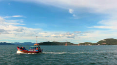 Motor boat in Nha Trang Bay on a background of cable car Vinpearl, Vietnam. Stock Footage