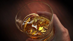 Whisky swirling in a glass Stock Footage