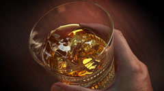 Whisky swirling in a premium glass Stock Footage