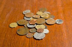 English shillings and pennies on the table - stock photo